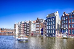 People at Tourist Boat Attraction in Amsterdam at Damrak Canal With Boat Royalty Free Stock Photos