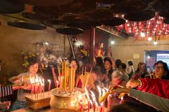 People and Tourist praying with Burning incense coils inside Man Mo Temple at Hollywood road, Sheung Wan district, landmark and royalty free stock photos