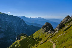 People on the tourist trail on the mountain peaks in the Western Tatras Stock Images
