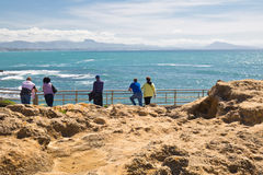 People tourists admiring the beauty of atlantic ocean coastline in biarritz, basque country, france Royalty Free Stock Photos