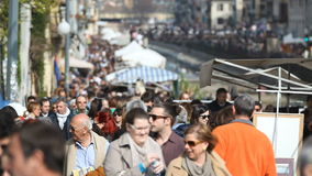 People and Tourists in Navigli Area Milan Italy