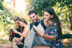 People tourists searching for direction using paper map Royalty Free Stock Photo