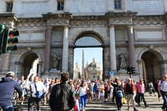 Tourists stroll at historical places at Rome stock photography