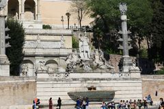 Tourists stroll at historical places at Rome royalty free stock photos