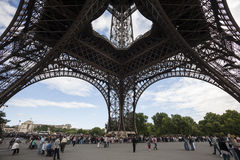 People and tourists visit Eiffel Tower in Paris Royalty Free Stock Photo