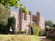 People tourists walking in the rain in front of the melford hall stock photography