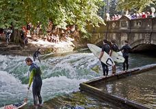 People and tourists watching surfers in center Munich Royalty Free Stock Photos