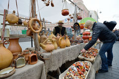 People trades clay pots Stock Images