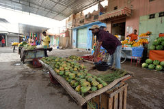 People trades fresh fruits in market in Rissani, Morocco Stock Photo