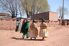 People in traditional clothes in Bolivian village, Andes Royalty Free Stock Photos