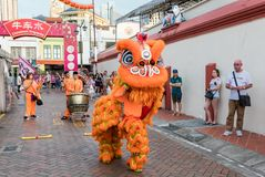 People in traditional costume perform the Chinese lion dance, Chinatown, Singapore. Singapore - March 24, 2018: People in traditional costume perform the Chinese Stock Photo
