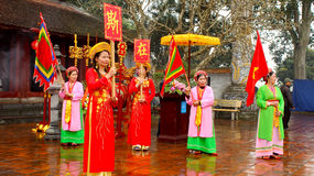 People in traditional costumes arrange letters Royalty Free Stock Image
