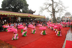 People in traditional costumes arrange letters in new year for luck at Mao Dien temple Stock Image