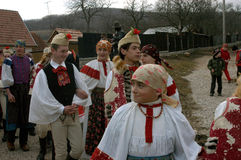 People in traditional costumes celebrating the winter carnival Stock Photo