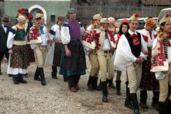 People in traditional costumes celebrating the winter carnival Stock Photography