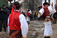 People in traditional costumes celebrating the winter carnival Royalty Free Stock Images