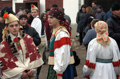 People in traditional costumes celebrating the winter carnival Royalty Free Stock Photos