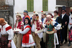 People in traditional costumes celebrating the winter carnival Royalty Free Stock Photo