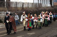 People in traditional costumes celebrating the winter carnival Stock Images