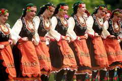 People in traditional costumes dance bulgarian horo a meadow royalty free stock photos