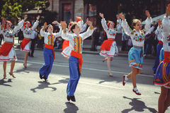 People in traditional costumes sing and dance Royalty Free Stock Photography