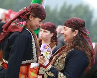 People in traditional folk costume of The National Folklore Fair in Koprivshtica. Koprivshtica, Bulgaria - August 7, 2010: People in traditional folk costume of stock photography