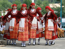 People in traditional folklore costumes Royalty Free Stock Images