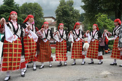 People in traditional folklore costumes Royalty Free Stock Photo