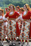 People in traditional folklore costumes Royalty Free Stock Image