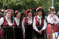 People in traditional folklore costumes Stock Photo