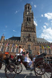 People on a traditional horse horse carriage in Bruges Stock Photography
