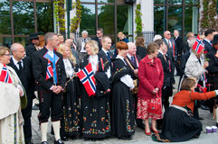 The people in traditional norwegian dress on the parade. At norwegian constitution day stock image