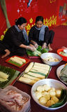 People with traditional Vietnamese dress making banhTet for Lun royalty free stock photo