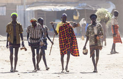 People in traditional village of Dassanech tribe. Omorato, Ethiopia. Royalty Free Stock Image