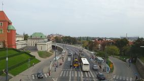 People and traffic on a busy downtown street in Warsaw, Poland. View from above. Stock footage stock footage