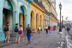 People and traffic in a colorful street in Havana Royalty Free Stock Images