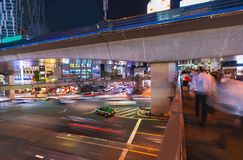 People and traffic crossing a busy intersection in Shibuya, Tokyo, Japan. Motion blurred view of people and traffic crossing a busy intersection in Shibuya Royalty Free Stock Image