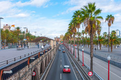 People & traffic, late afternoon in seaside Barcelona, Spain. Stock Photography