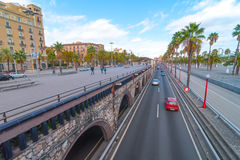 People & traffic, late afternoon in seaside Barcelona, Spain. Stock Images