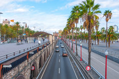 People & traffic, late afternoon in seaside Barcelona, Spain. Royalty Free Stock Photography