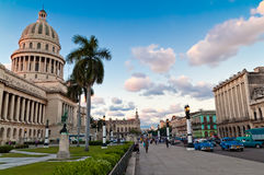 People and traffic outside the Capitol in Havana Royalty Free Stock Photo