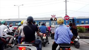 People and traffic traveling on the road. The people and traffic traveling on the road stock video footage