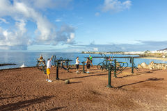 : people train at the outdoor fitness station Stock Image