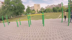 People train on an outdoor sports field in summer stock video