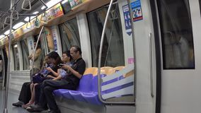 People on the train station in Singapore. Unidentified people on the Mass Rapid Transit train in Singapore. The MRT network encompasses 170.7 kilometres (106.1 stock video