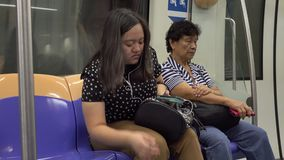People on the train station in Singapore. Unidentified woman sitting on the Mass Rapid Transit train in Singapore. The MRT network encompasses 170.7 kilometres ( stock video