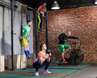 People are training at the cross fit gym stock photos