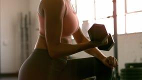 People training in crossfit gym stock video footage