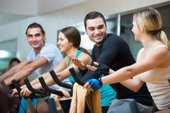People training on exercise bikes Royalty Free Stock Photography