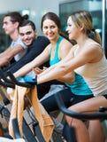 People training on exercise bikes Royalty Free Stock Photo
